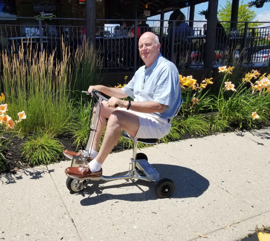 Mike M on HandyScoot at garden